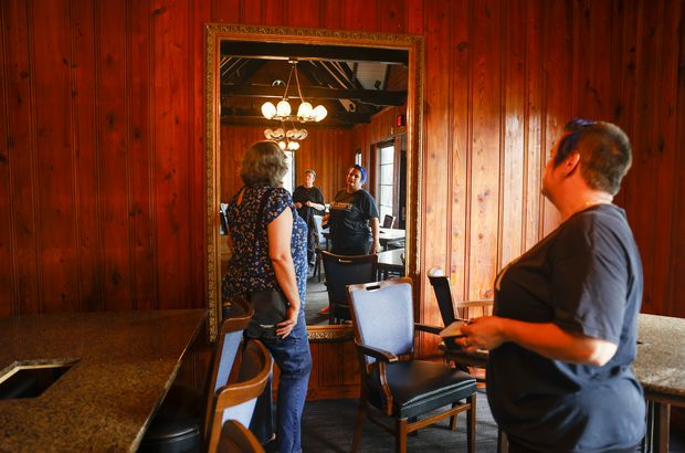 Brandy Stark, right, and Marina Spears look at a mirror while walking through the former Melting Pot.