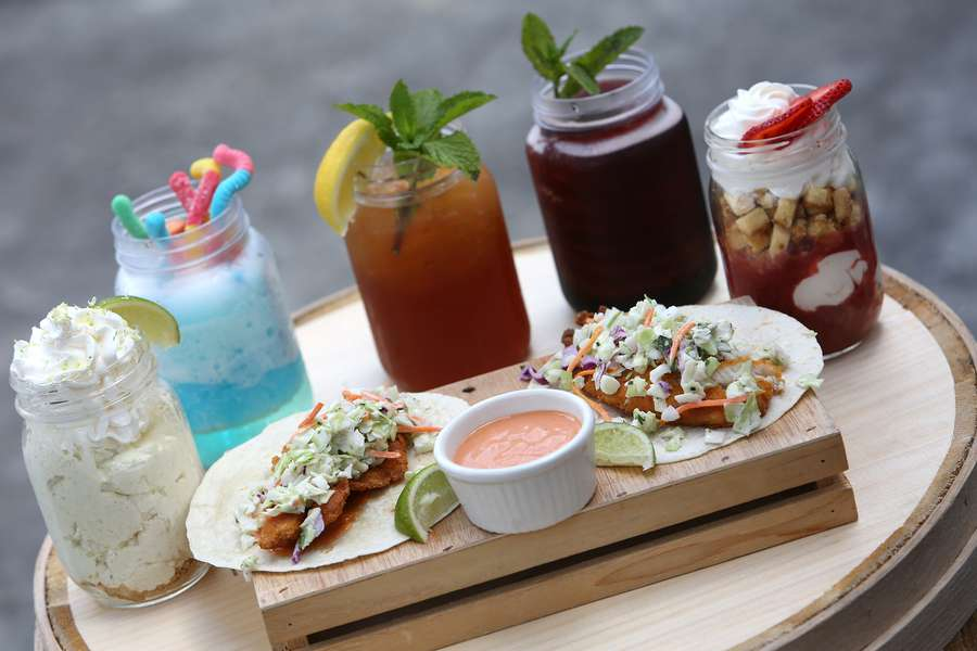 The Roaring Springs ride will have upgraded food options like fish tacos with spicy remoulade. Zoo Tampa at Lowry Park will also have, back row left to right, deconstructed key lime pie, a kids icee, bourbon ice tea, a Cherry Coke Jack Daniels icee and deconstructed strawberry shortcake. JAMES BORCHUCK | Times