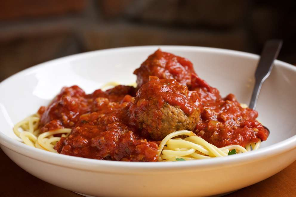 There is serious comfort in a bowl of pasta at Olive Garden, including the create-your-own combination of spaghetti and meatballs. [Photo by Deb Lindsey for the Washington Post]