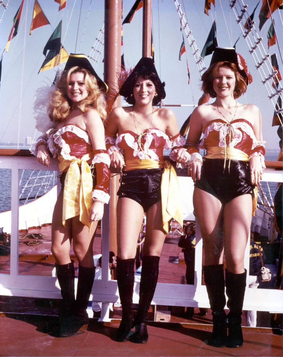 Doria Gomez, Elena DelRio and Linda Gomez pose in 1979 during the 75th anniversary of Gasparilla. [Steve Baird | Times archives]