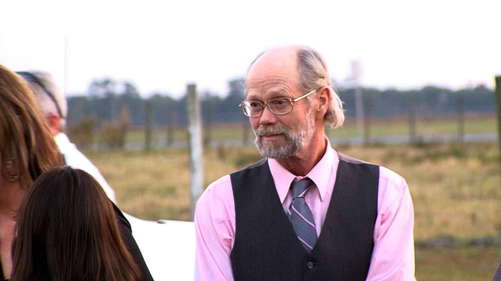 Hal Rogers stands outside Florida State Prison near Starke while his niece addresses the media after the Nov. 15, 2011 execution of Oba Chandler, the man who killed Rogers' wife and two daughters more than two decades earlier. [Photo courtesy of GTN News]