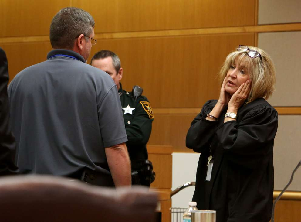Circuit Court Judge Chris Helinger, right, talks with Bay New 9 Photojournalist Michael Brantley, left, in court, Tuesday. The discussion centered around camera angles and what could be seen in video images in the courtroom. It was the second time Tuesday the judge stopped the trial to address a problem she perceived with the news coverage. [SCOTT KEELER | Times]