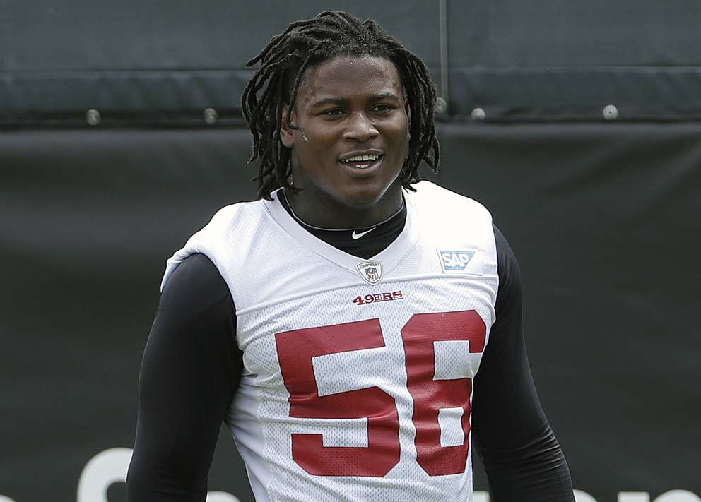 Reuben Foster walks on the field during a practice at the 49ers' training facility in Santa Clara, Calif. [AP Photo/Jeff Chiu, File]