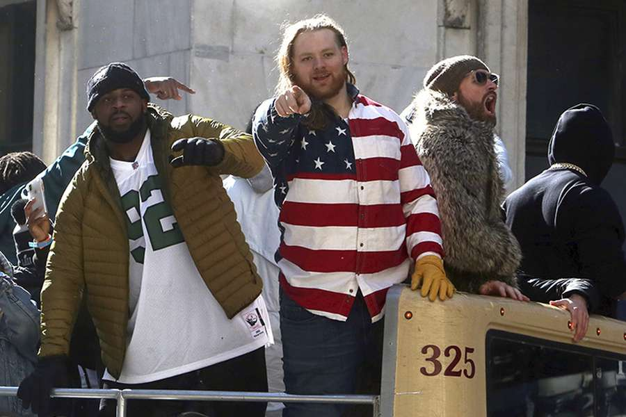 Beau Allen, center, celebrates the Eagles' Super Bowl LII victory with Fletcher Cox and Chris Long during the team parade February in Philadelphia. [Associated Press]