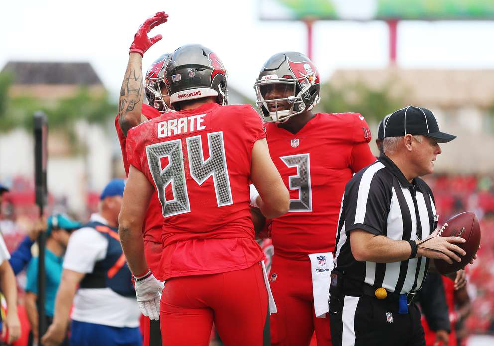 Bucs tight end Cameron Brate (84) celebrates a touchdown reception with wide receiver Mike Evans (13) during the first quarter. [MONICA HERNDON | Times]