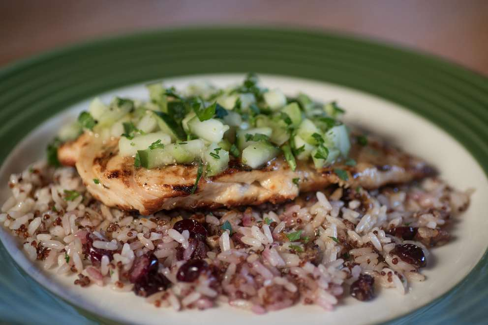 Cedar-grilled lemon chicken sits on a bed of quinoa jazzed up with dried cranberries at Applebee's. [Photo by Dixie D. Vereen for the Washington Post]