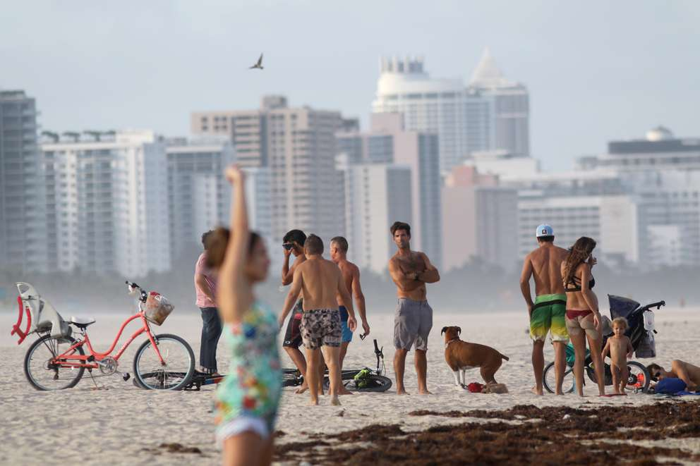 Families visit on South Beach in Miami. [DOUGLAS R. CLIFFORD | Times>