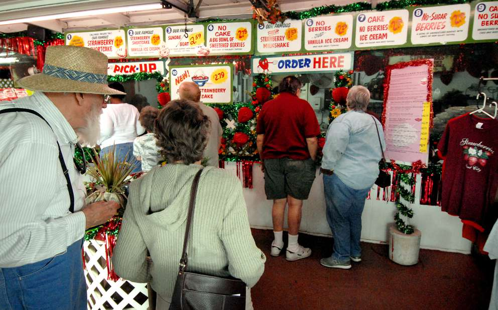 Customers wait in line for strawberry shortcake at the Parksdale Farm Market produce stand outside of Plant City. (Times, 2008)