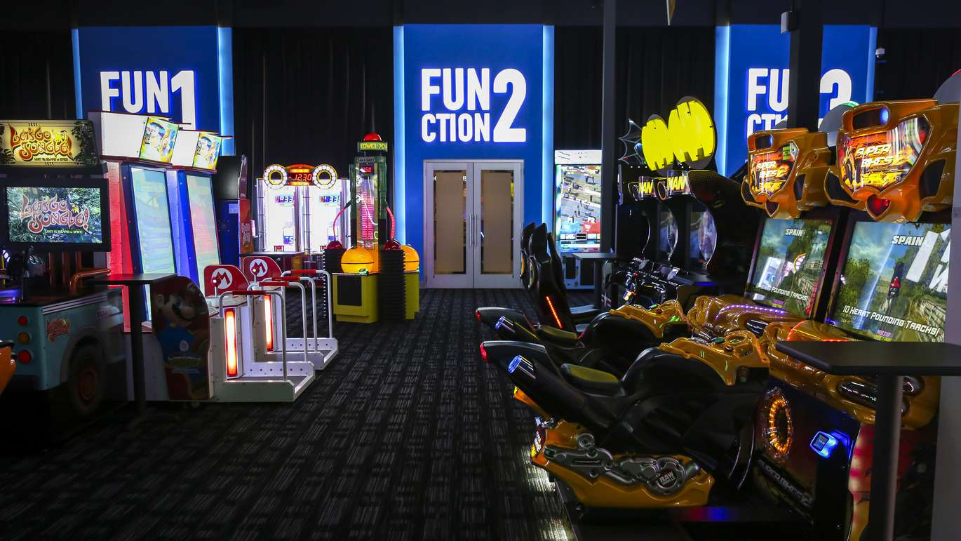 Arcade games line the floor in front of the rentable private rooms at Dave & Buster's in Tampa. [WILL VRAGOVIC   Times]