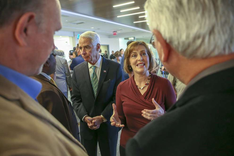 CHRIS URSO | Times Rep. Kathy Castor, right, and Rep. Charlie Crist, speak to local union delegates following a news conference Tuesday, Jan. 22, 2019 at Tampa International Airport. Castor and Crist were joined by local federal workers to highlighting the negative impact of the shutdown and calling for government to re-open.