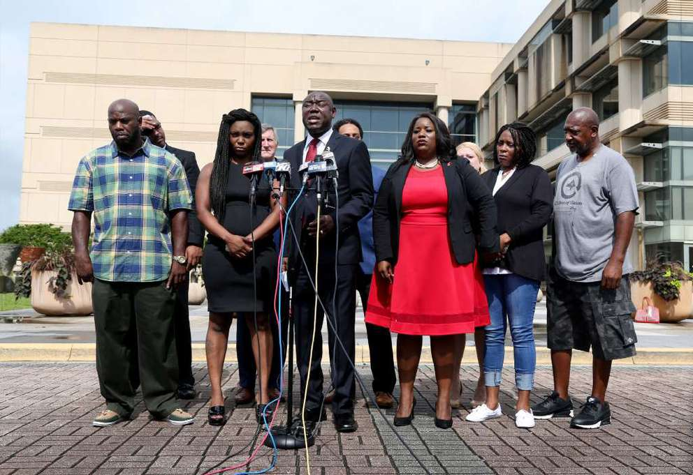 Well-known civil rights attorney Ben Crump, center, flanked by Britany Jacobs, left, and Clearwater attorney Michele Rayner, right, announces on July 26 that he is joining the McGlockton case. DOUGLAS R. CLIFFORD | Times