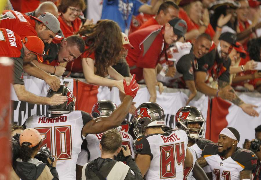 Fans celebrate Adam Humphries' 109 yard kick six during the Bucs' preseason game against the Lions in August. [JIM DAMASKE | Times]