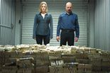 "Skyler and Walter White, played by Anna Gunn and Bryan Cranston, survey a mountain of cash in a storage locker on an episode in the fifth season of ""Breaking Bad."""